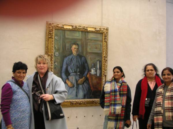 "in front of ""the woman and the coffee pot"" by Paul Cézanne"